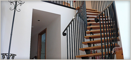 Wrought iron stair with oak treads